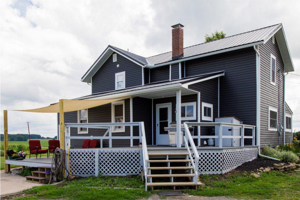 Back porch of restored home after storm damage