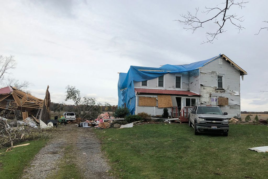 Emergency tarp services at this storm-damaged house