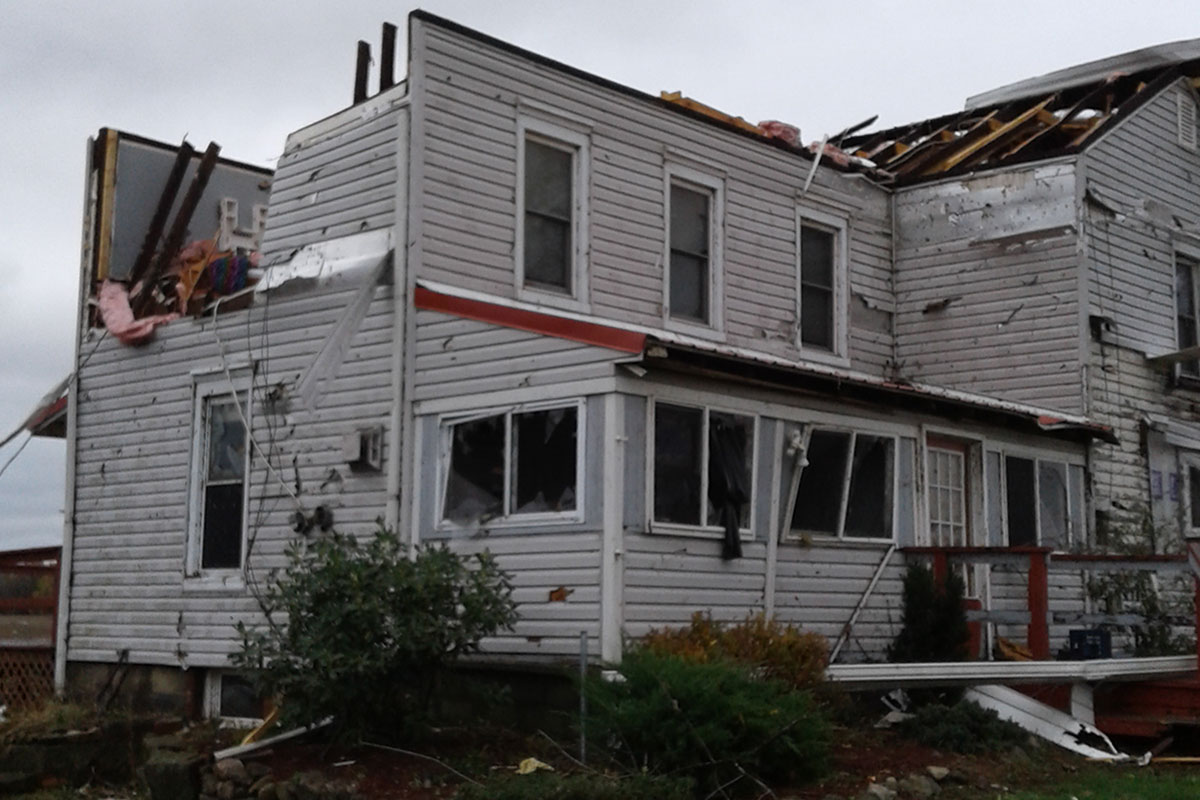 Tornado damage to a single-family house in Williamsfield, OH